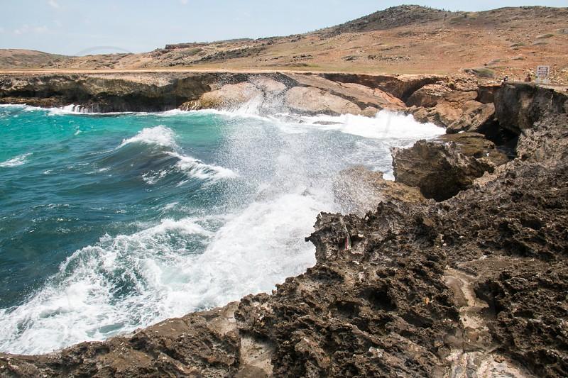 Rocky beach on a desert island. photo
