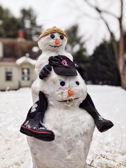 white snowman with hat and cap photo