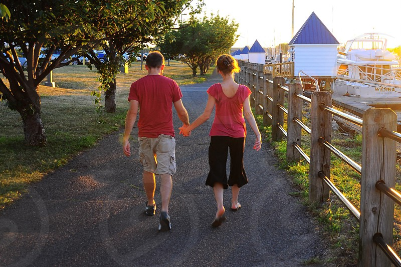 man and woman walking on pathway photo