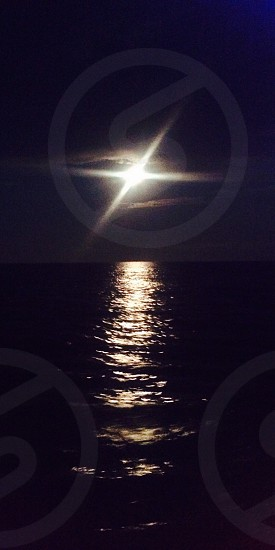 The Moon lighting up the ocean of Sunny Beach Bulgaria. Boat perspective ... photo