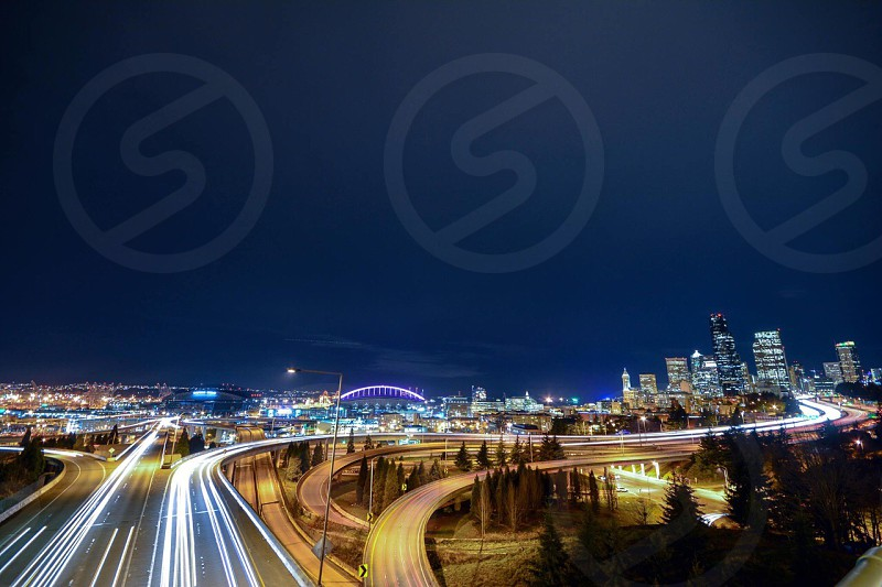 cars on the road in fast motion during nighttime in time-lapse photograph photo