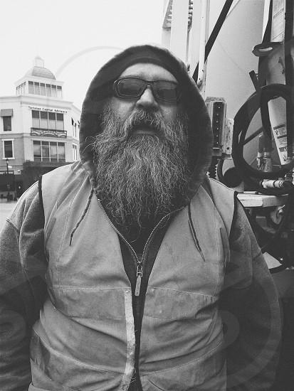 graysclae of bearded man in hoodie jacket wearing black sunglasses photo