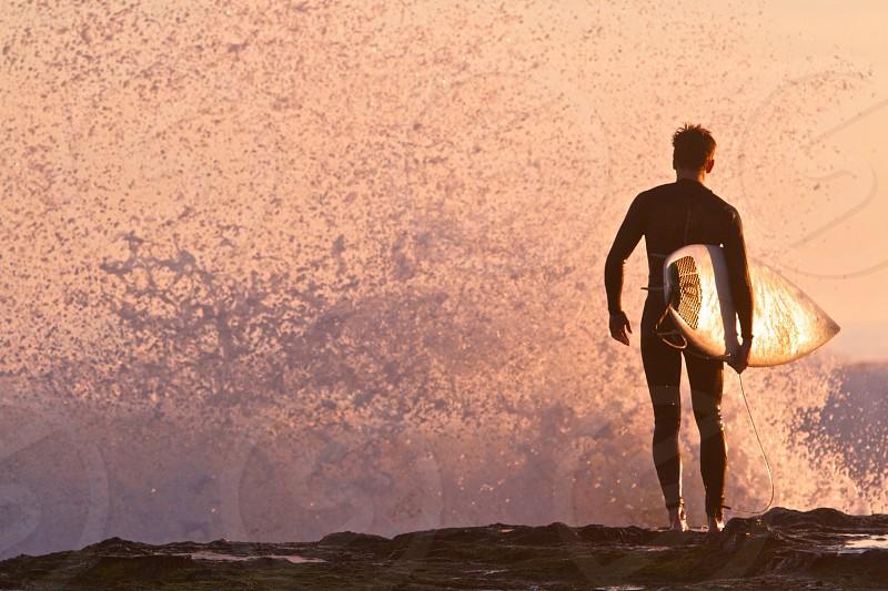 Surf surfer wave sunset silhouette ocean dusk beach photo