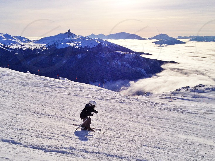 Cloudy days in the valley may still mean glorious views and sunshine at The Peak. Whistler British Columbia.  photo