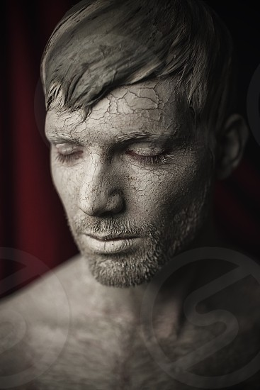 Portrait of Athletic Young Men with Skin Covered in Mud. photo