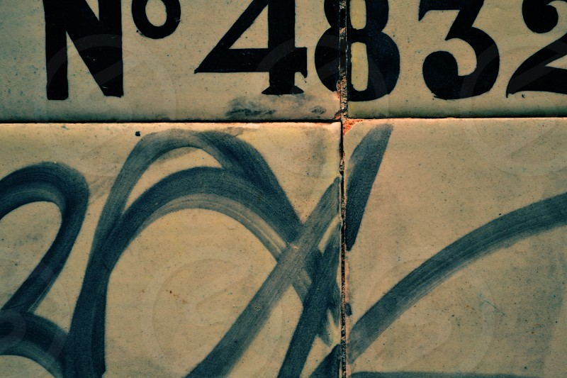 tiles. madrid spain facade tag number 4 8 3 2 street ceramic photo