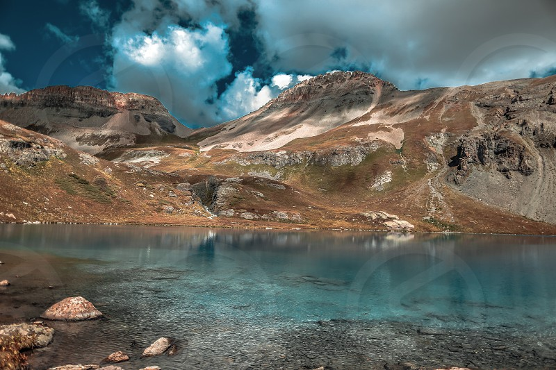 Beautiful ice lakes on top of the mountain in early autumn. photo