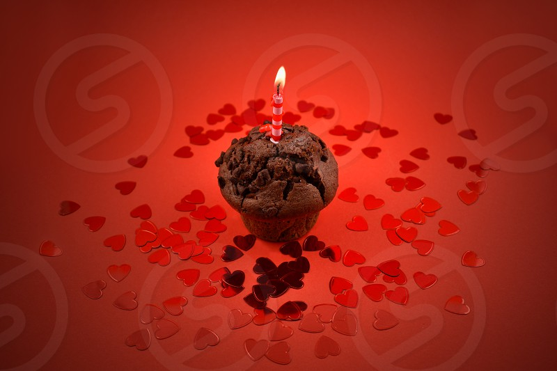 Muffin With Candle Chocolate Muffin With Heart On A Red Background Sweet Birthday Pastry Valentines Day Concept By Beata Filarova Photo Stock Snapwire