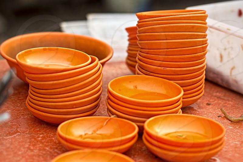 Stack orange bowls photo