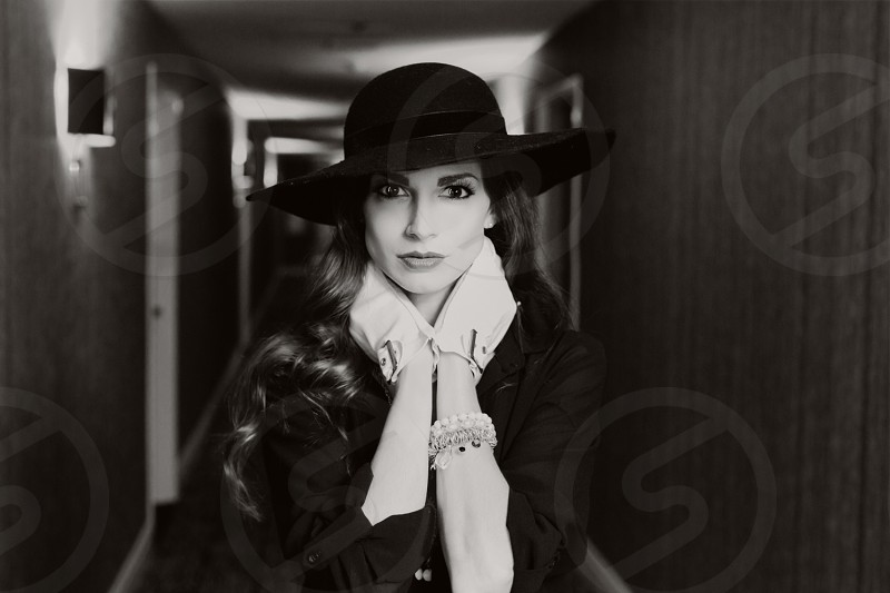 black and white gloves black hat woman hotel hallway photo