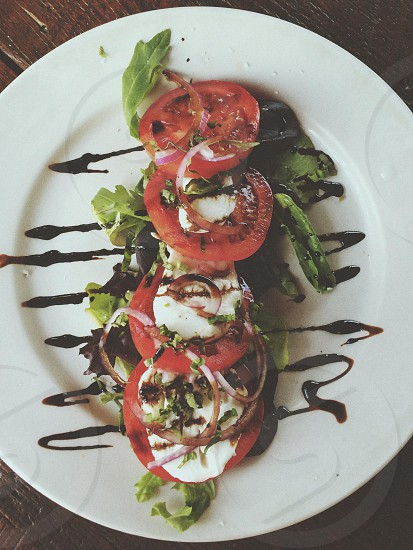 tomatoes and egg dish on white ceramic plate photo