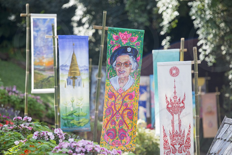 flags with pictures of the Tahi Royal Family at the Mae Fah Luang ornamental garden at the village of  Doi Tung north of the city of Chiang Rai in North Thailand. photo