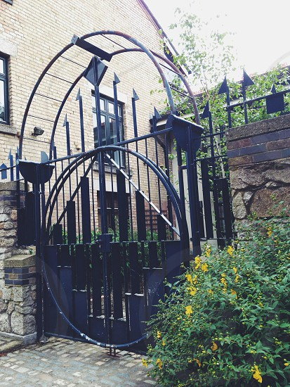iron gate between stone walls photo