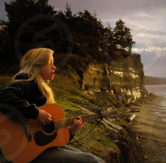High School senior girl playing guitar at West Beach on Whidbey Island WA photo