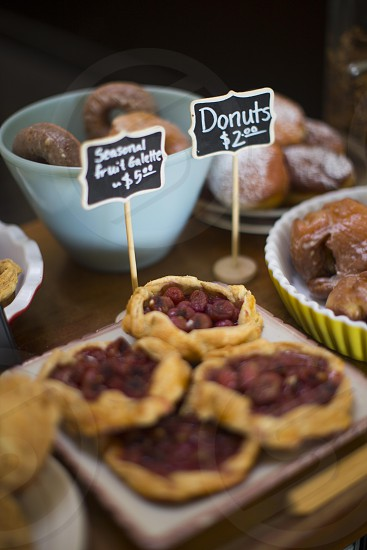 donuts and seasonal fruit galette on display in tilt shift lens photo