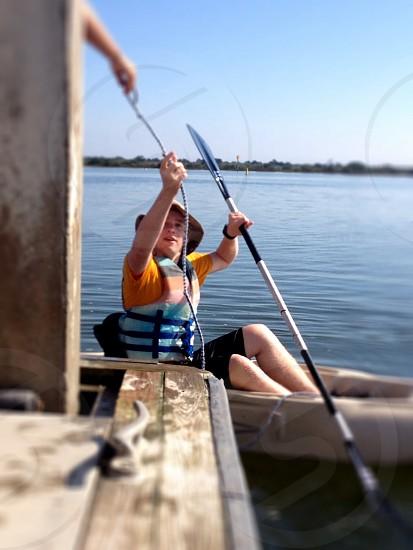 man holding boat paddle photo