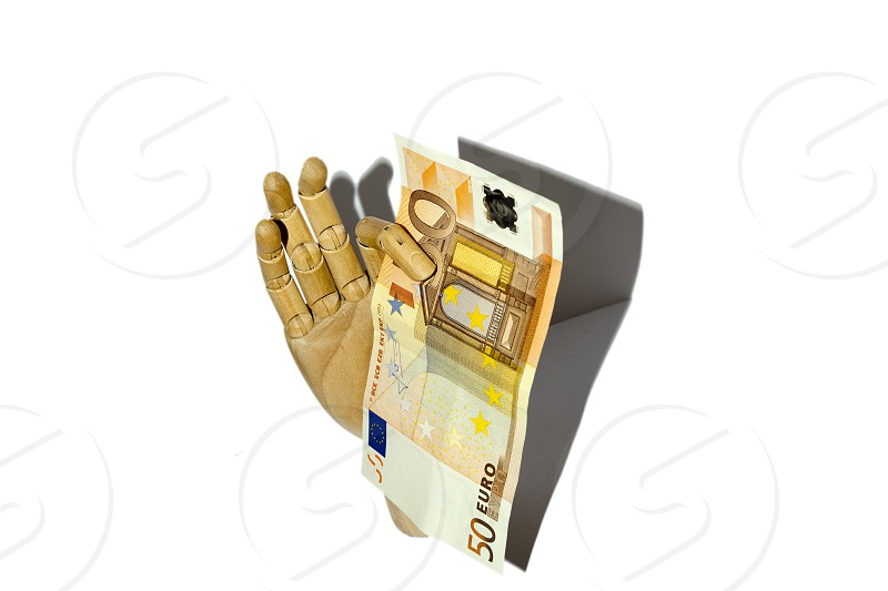Wooden hand holding euro currency photo