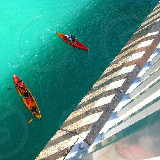 shot from above. orange canose on turquoise water photo