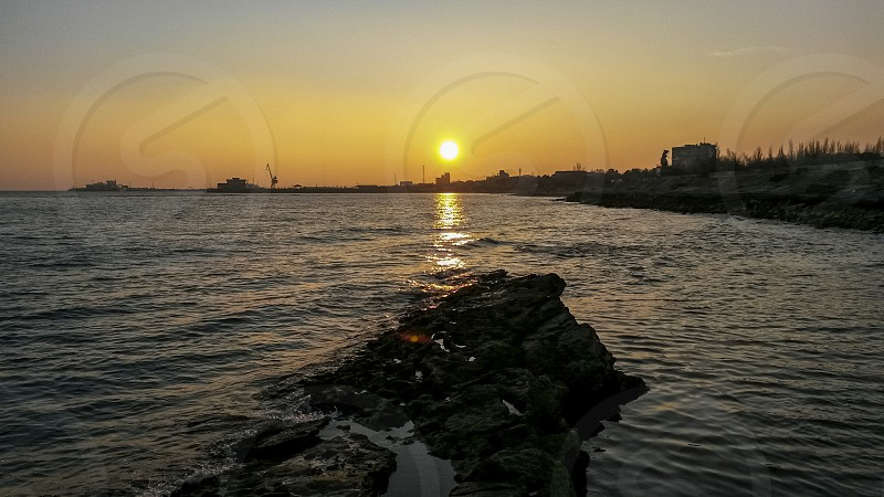 Sunset over Caspian sea in the winter  photo