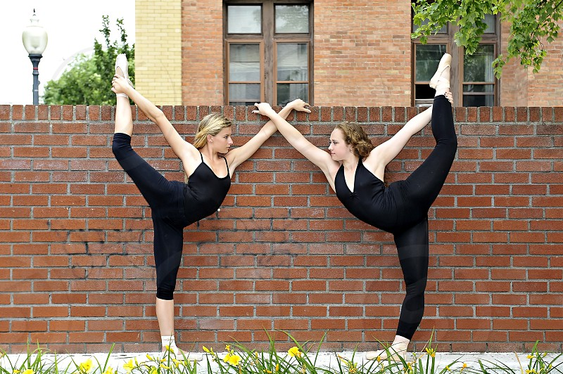Two female dancers in a urban outdoor setting. photo