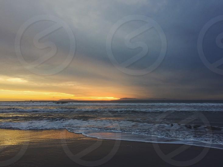 sea waves on sunrise photo