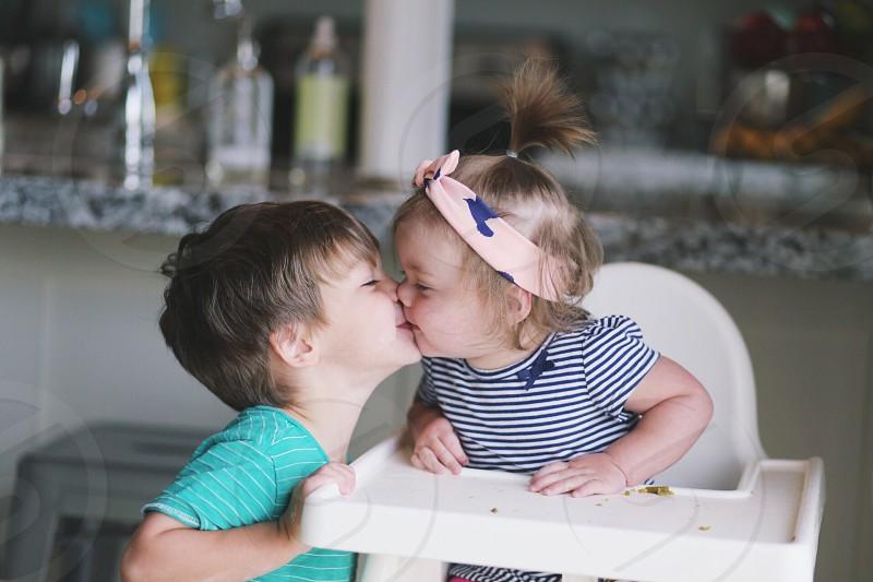 Sibling kisses photo