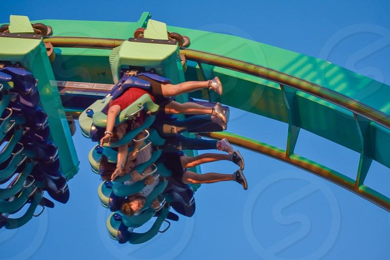 Orlando Florida . February 26  2019. People having fun terrific Kraken rollercoaster at Seaworld Theme Park (12) photo