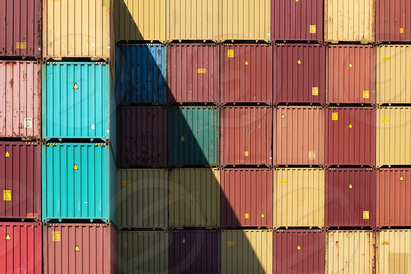 Intermodel shipping containers stacked in a row photo