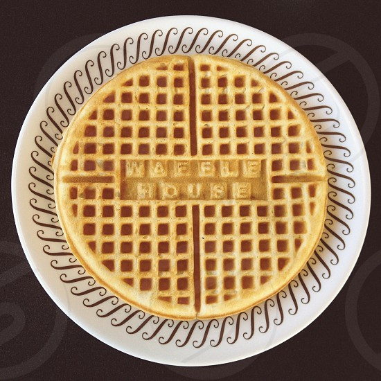 brown waffle with waffle house sign on white plate photo