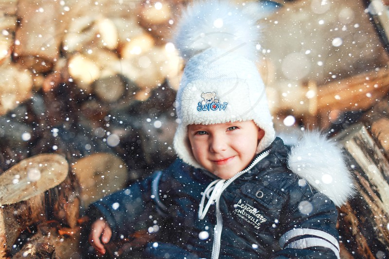 children playing with snow winter happy face portrait photo