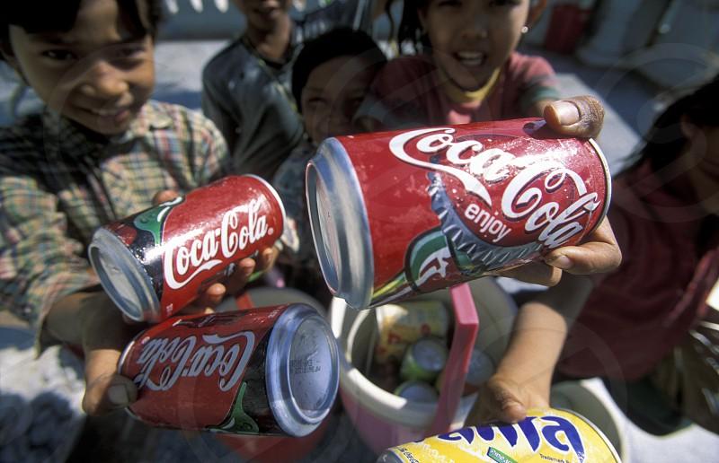 coca cola salers in the city of phnom penh in cambodia in southeastasia.  photo