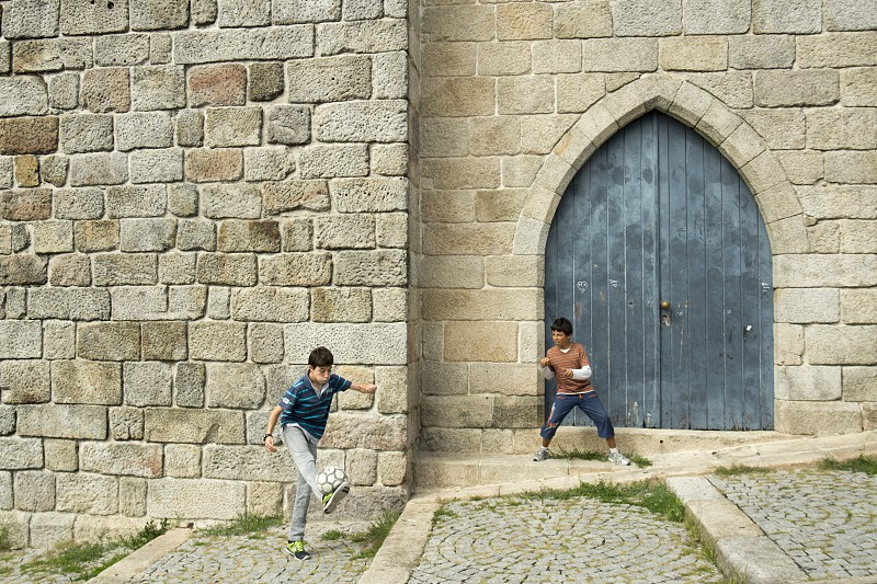 boys plas street soccer near the cathedral se in ribeira in the city centre of Porto in Porugal in Europe. photo