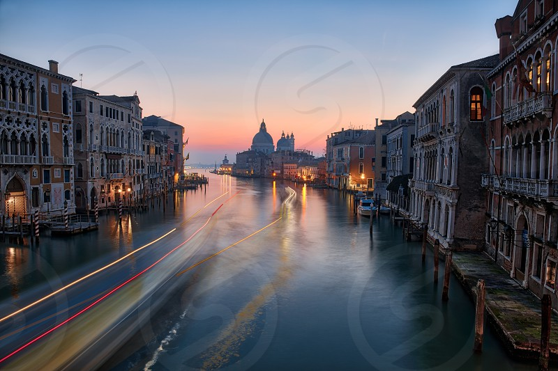 long exposure on the gran canal in venice during a winter morning photo