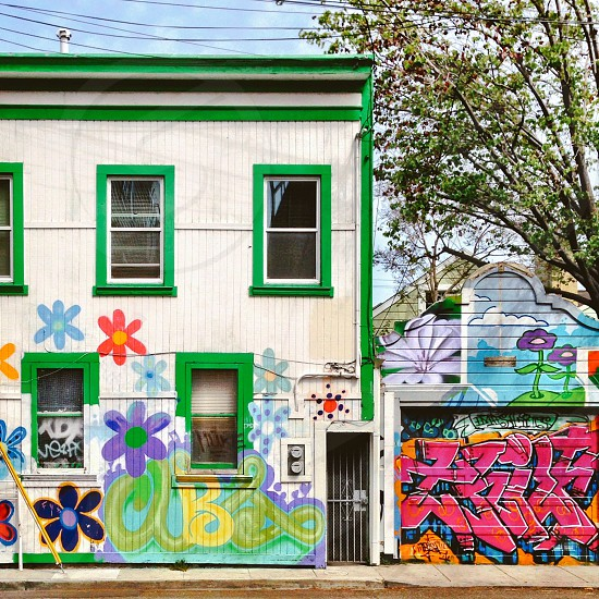 Colorful house with mural trees and sky.  photo