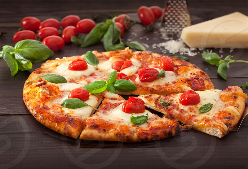 Fresh vegetarian pizza with fresh tomatoes and basil photo