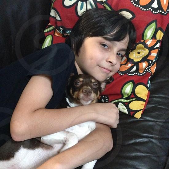 Snuggles. Kid and dog photo