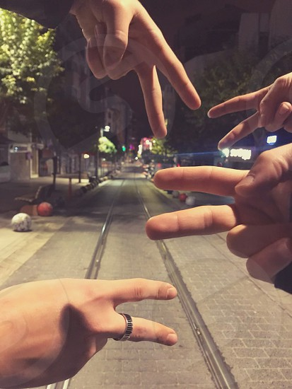 friends peace hand night out road street train railroad fingers two photo