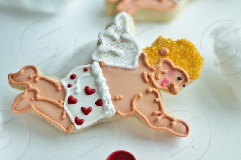 Cute Cupid decorated cookies with heart underwear boxers for valentine's day. photo