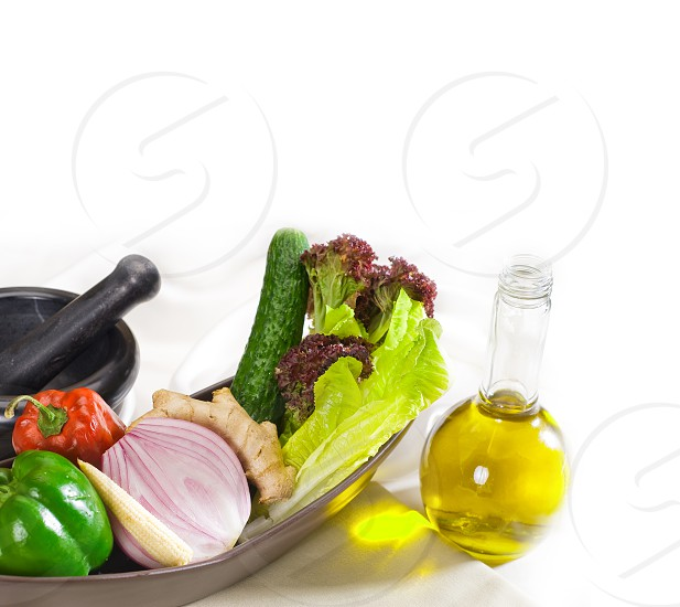assorted fresh vegetables  and extra virgin olive oil base for a healty diet and nutruition photo