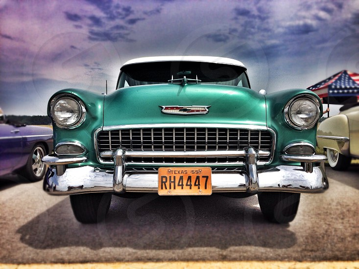 Classic car Chevy 1956 green grill front end headlights hood photo