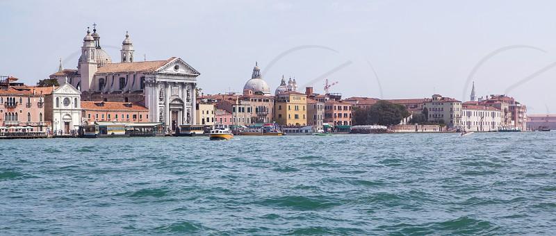 Aerial view at San Giorgio Maggiore island Venice Italy. Panorama of old Venice Italy. photo