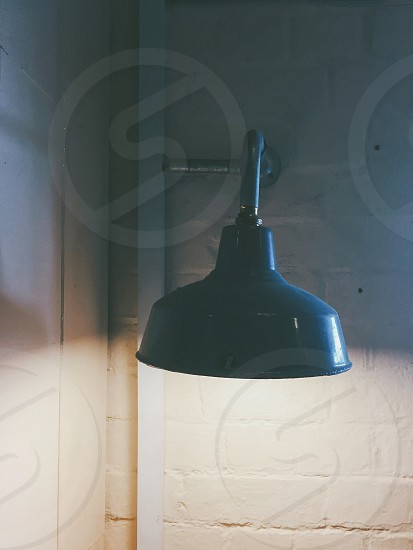turned on black sconce photo