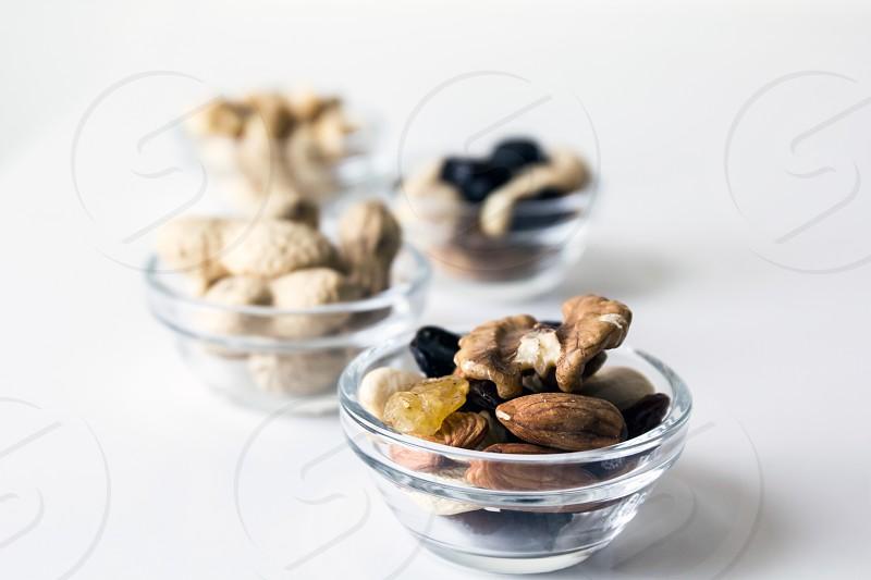 Food; nuts; snack; healthy; raisins; nuts; peanuts; almonds; cashews; chestnuts; monkey nuts;  photo