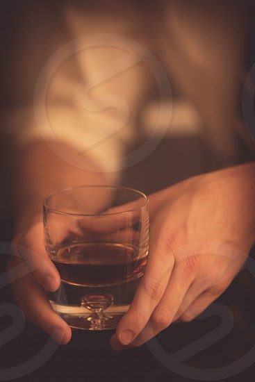Young Professional Holding Drink in Hands photo