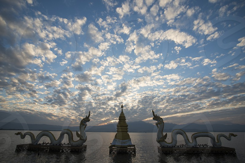 the phayanak or Naga Statue in the landscape at the lake of Kwan Phayao in the city of Phayao in North Thailand. photo