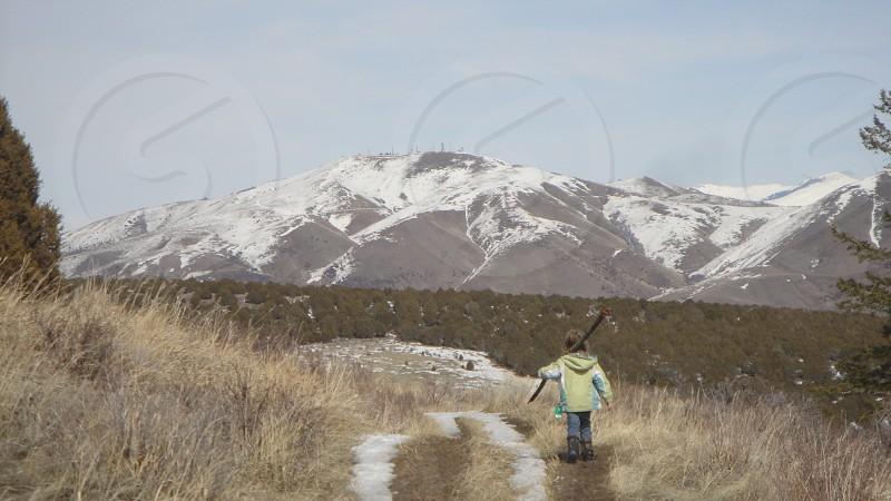 girl walking within field  photo