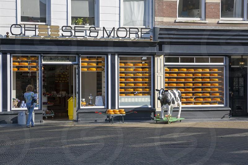 Dutch cheese shop on the Main Market Square in front of the Delft City Hall photo