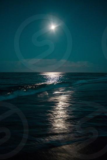 ocean moon beach shore photo