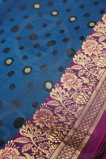 Peacock blue purple gold silk fabric textiles design flowers and polka dots photo