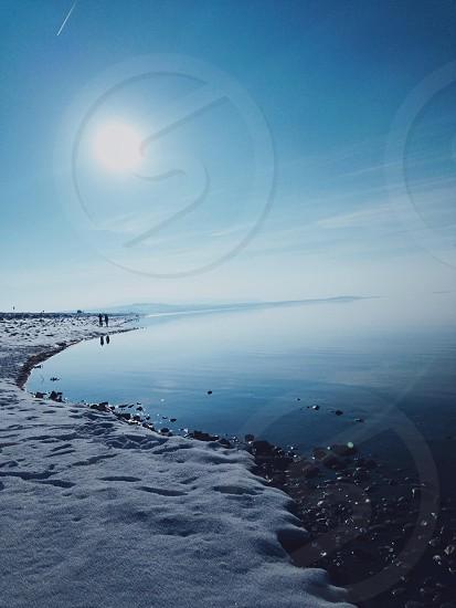 sea shore with sun photo